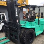 Turquoise forklift front view